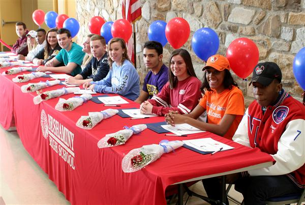 NHS senior athletes sign college letters