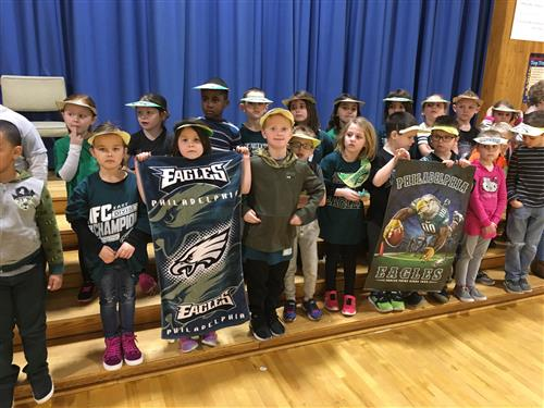 Eagles fans hold up gear