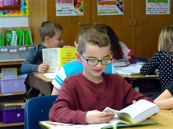 Rotary Clubs donate dictionaries to 3rd grade