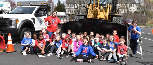 Hoover Elementary students pose next to a front end loader