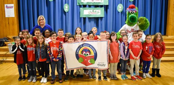 Phillie Phanatic poses with a class at Walter Miller Elementary School