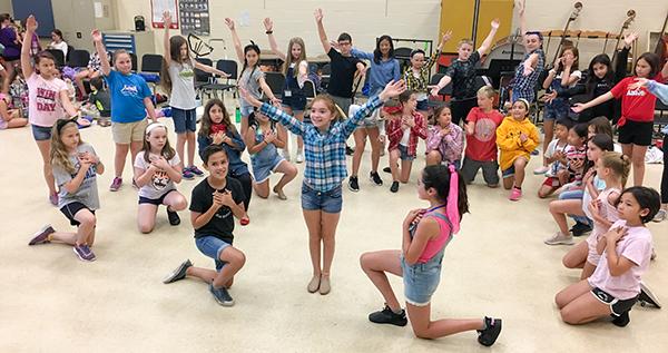 Cast of Annie Junior rehearses
