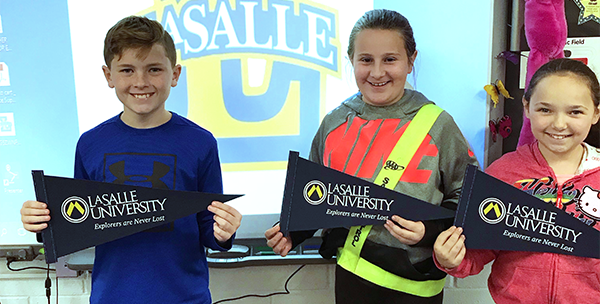 Ferderbar students hold up LaSalle College flags