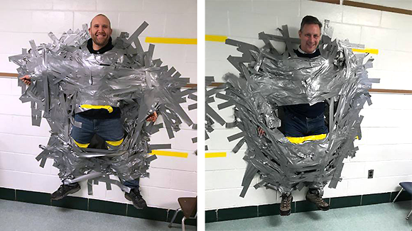 Buck principal, teacher duct taped to the wall