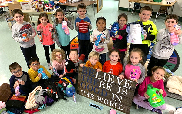Buck first-grade class with kindness sign