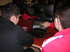 Students at the technology Help Desk at NHS