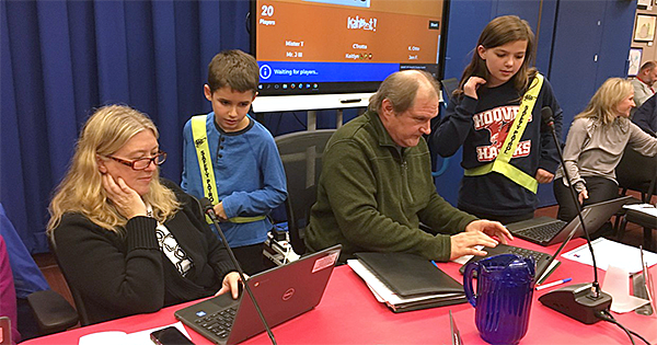 Hoover students help Board members play an online game
