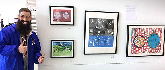 Justin Bursk with student artworks
