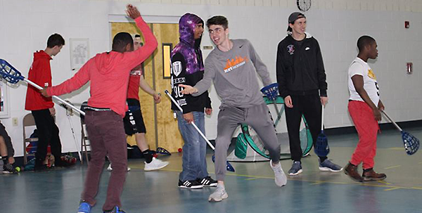 Lacrosse team visits Woods students