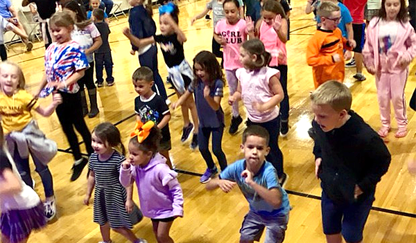 Students dancing at Walter Miller Elementary