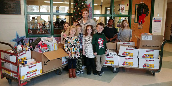 Students with food donations at Walter Miller Elementary