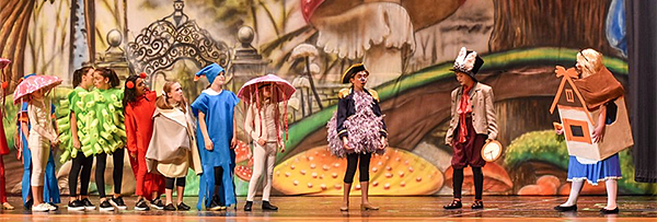 Alice in Wonderland cast on stage