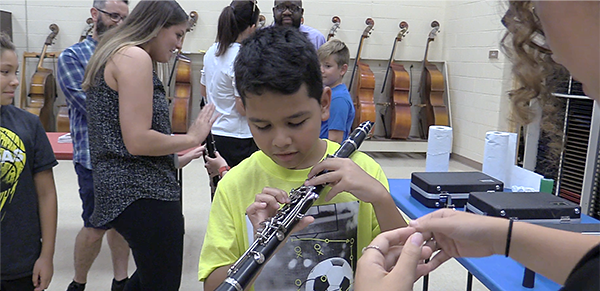 Student tries out a clarinet at Music Discovery Night