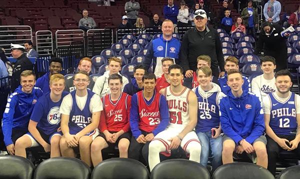 Ryan Arcidiacono with Neshaminy students at a Sixers game