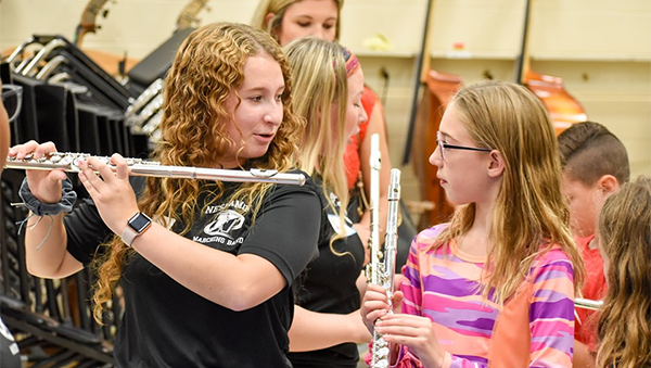 Neshaminy HS musician works with a younger student