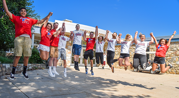 Neshaminy HS students jumping in front of the school