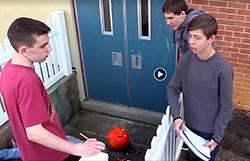 Students examine a mock crime scene