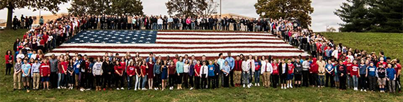 Maple Point students pose with veterans outside the school