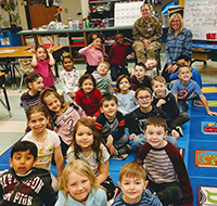 Macey Smith with a class at Walter Miller Elementary School