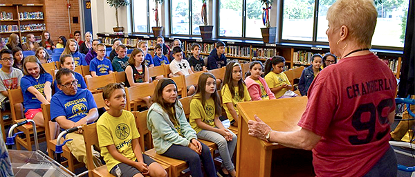 Rotary Club President speaks to students in the Poquessing library
