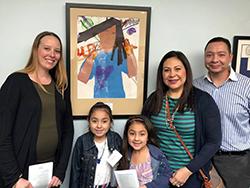 Schweitzer ES artist with her teacher and family