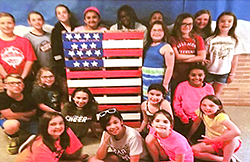 Students with American flag pallette