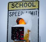 School sign in the snow