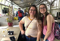 Students in a greenhouse at the STEAMM Day