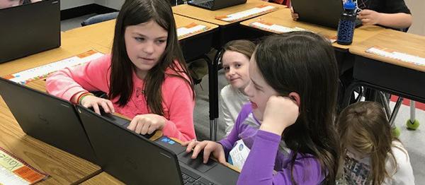 Tawanka buddies work on Chromebooks