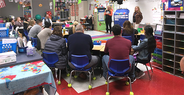 Parents attending a kindergarten presentation