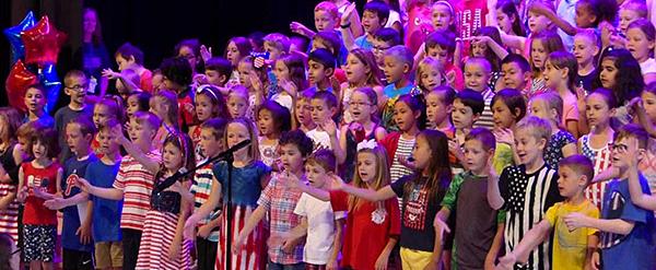 Tawanka students on stage singing