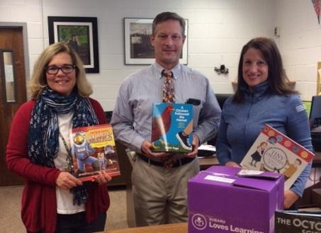 Car dealer donates 100 books to Buck