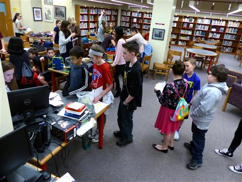 Maple Point library card distribution